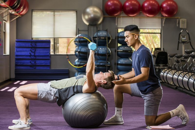 ACC Exercise Science students Paula Korzeniewski and Eric Mendoza pose for the new promotional poster for the program on Thursday, August 9, 2018 at the Riverside campus gym.